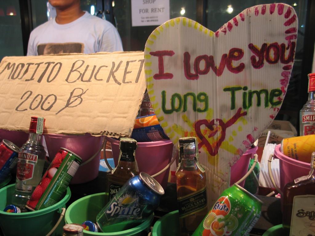 A buckets bars sign on the beach in Haad Rin